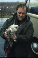 Bobby Tulloch holding a Gyrfalcon